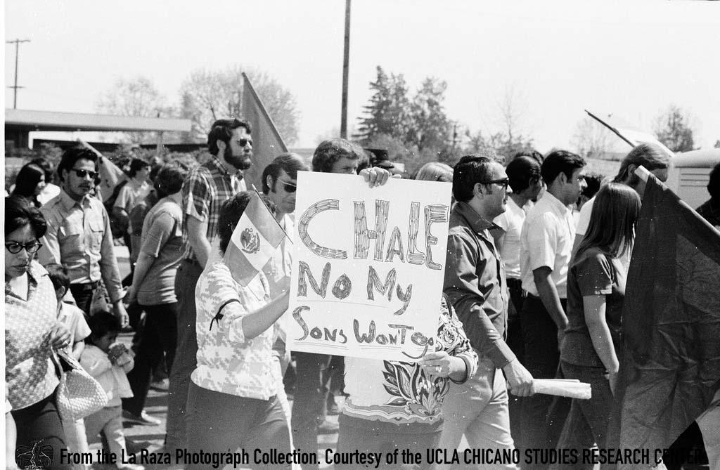 CSRC_LaRaza_B5F3C4_PA_015 People march at Fresno Moratorium | Pedro Arias, La Raza photograph collection. Courtesy of UCLA Chicano Studies Research Center
