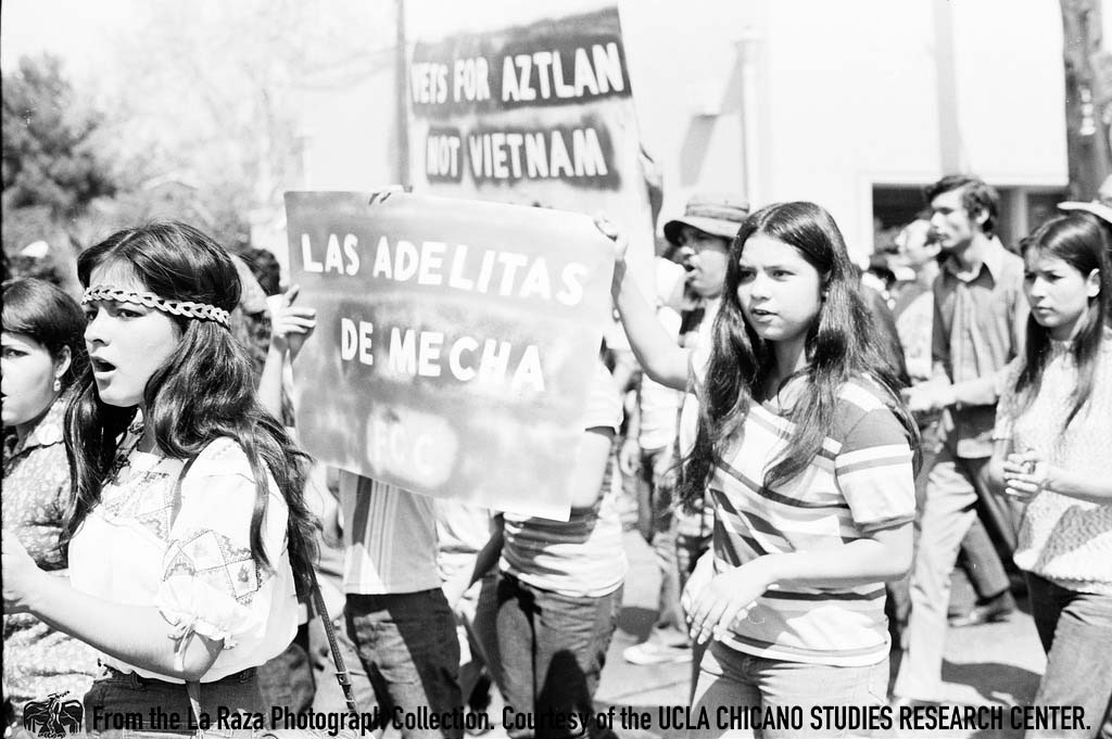 CSRC_LaRaza_B5F3C6_RR_032 Women march at Fresno Moratorium | Raul Ruiz, La Raza photograph collection. Courtesy of UCLA Chicano Studies Research Center