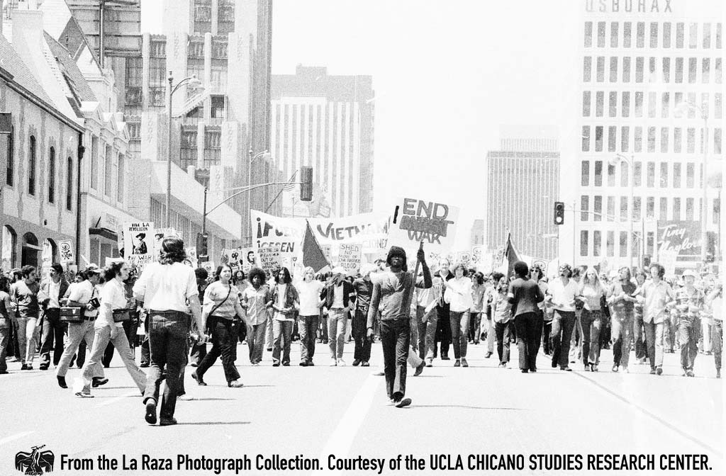 CSRC_LaRaza_B5F7C1_Staff_009 Protesters marching down Wilshire Boulevard at an anti-Vietnam War demonstration | La Raza photograph collection. Courtesy of UCLA Chicano Studies Research Center