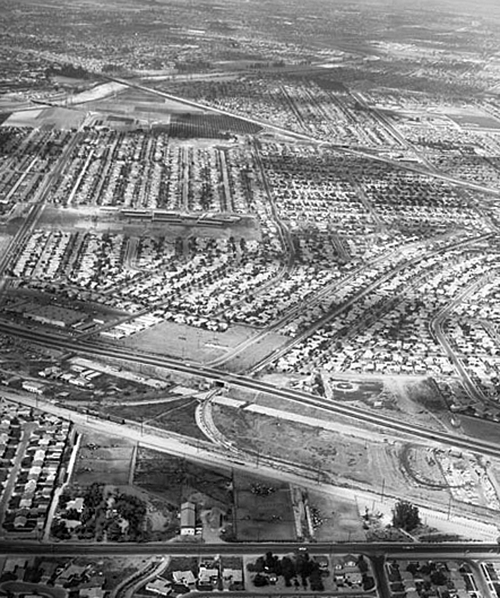 Dairy and owner's house surrounded by tract homes in Downey in 1957. Photo Courtesy of Kelly-Holiday Collection of Negatives and Photographs​, ​Los Angeles Public Library