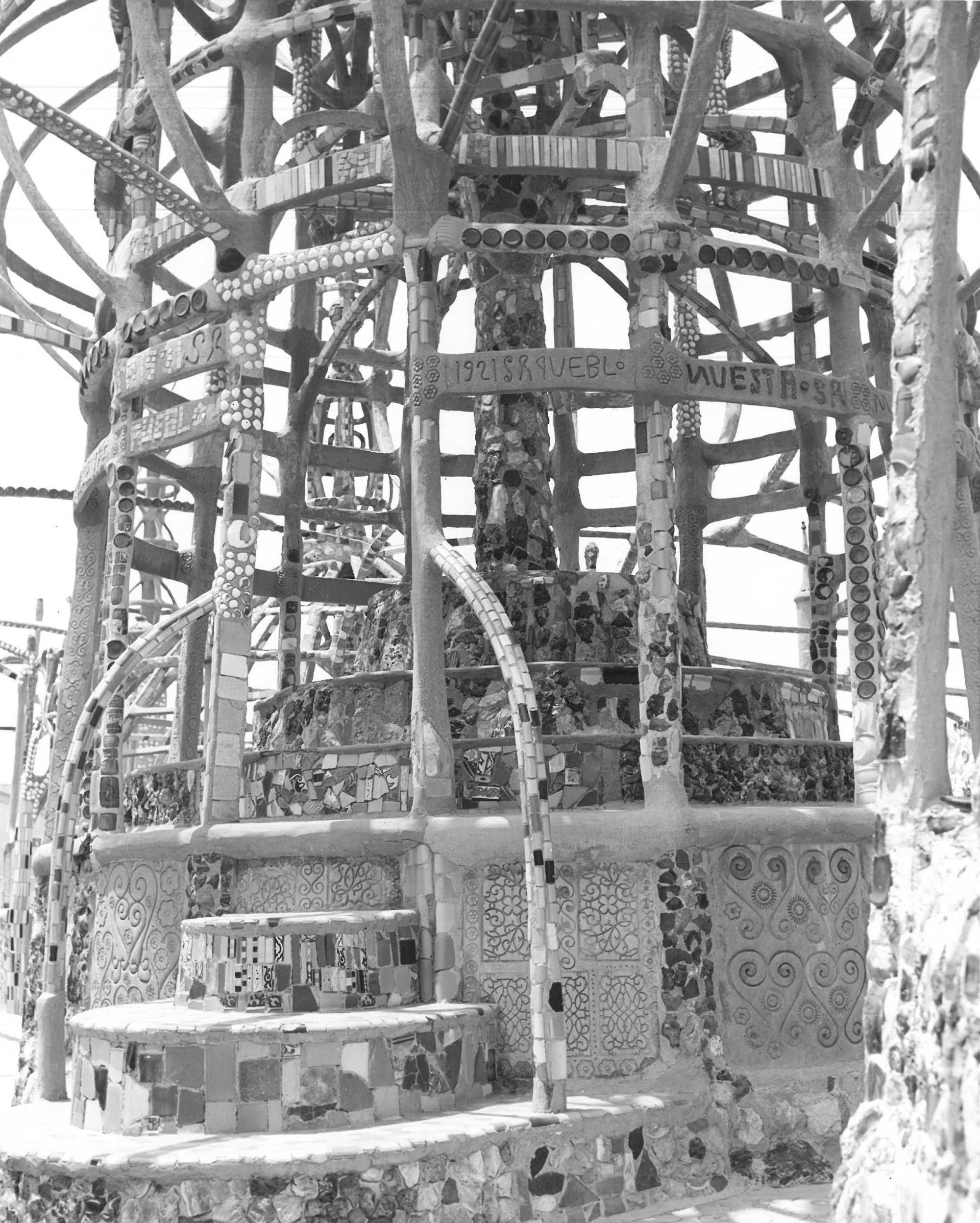 A photo showing damage to Watts Tower C, July 1959