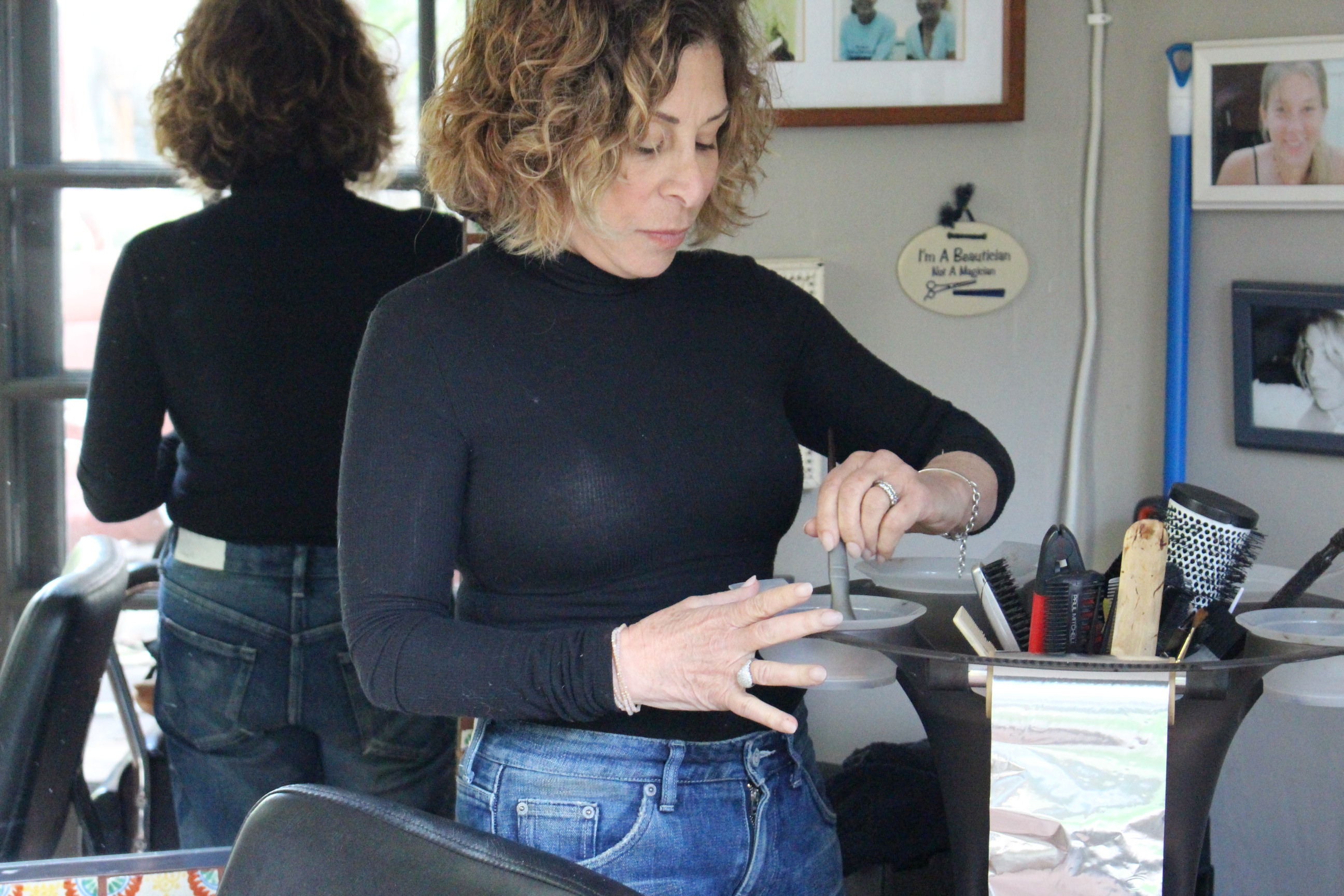 Dana Gache, hairstylist, mixing color at her studio