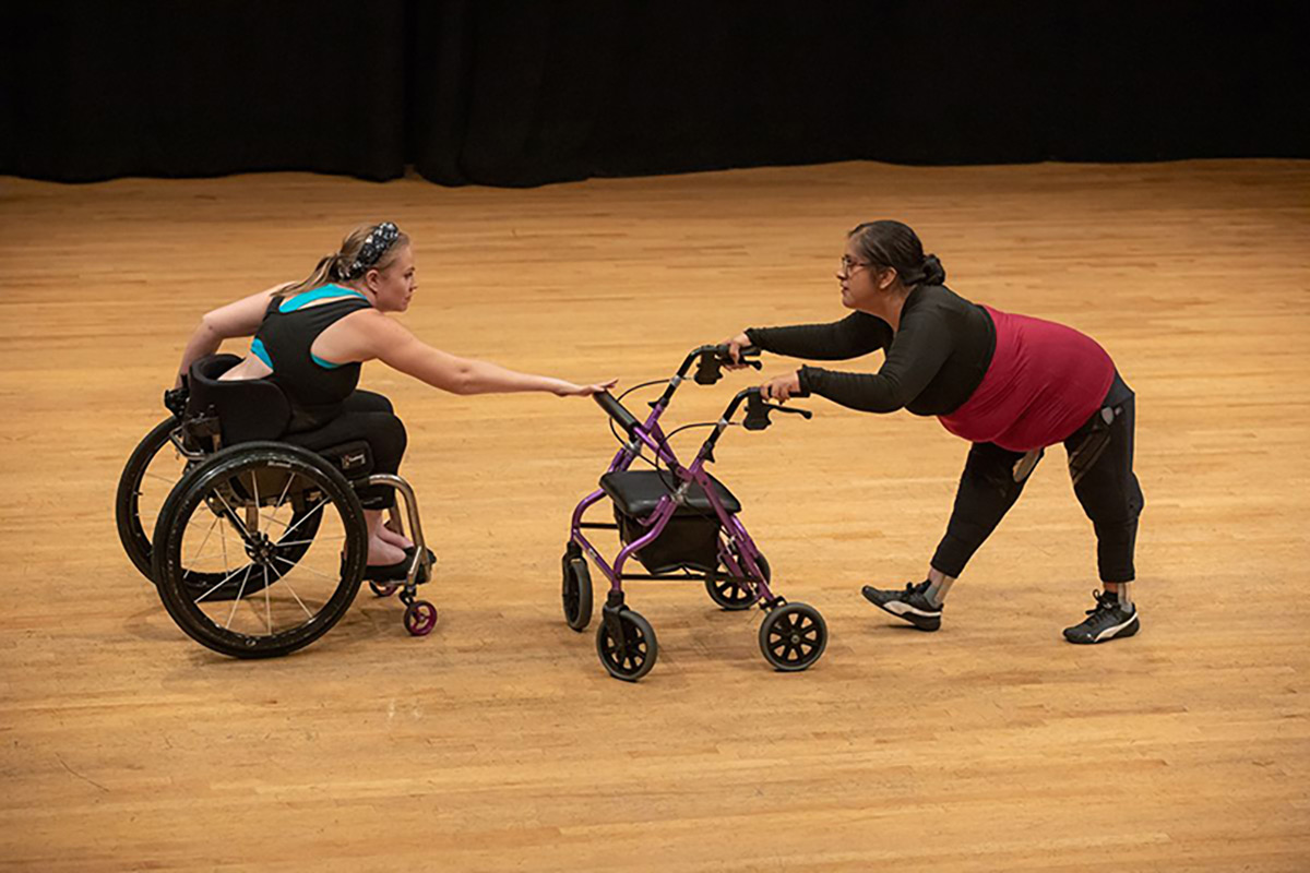 Harmanie Taylor, left, and Vanessa Cruz perform a duet during the Dancing Disability Lab at UCLA. | Reed Hutchinson/UCLA.