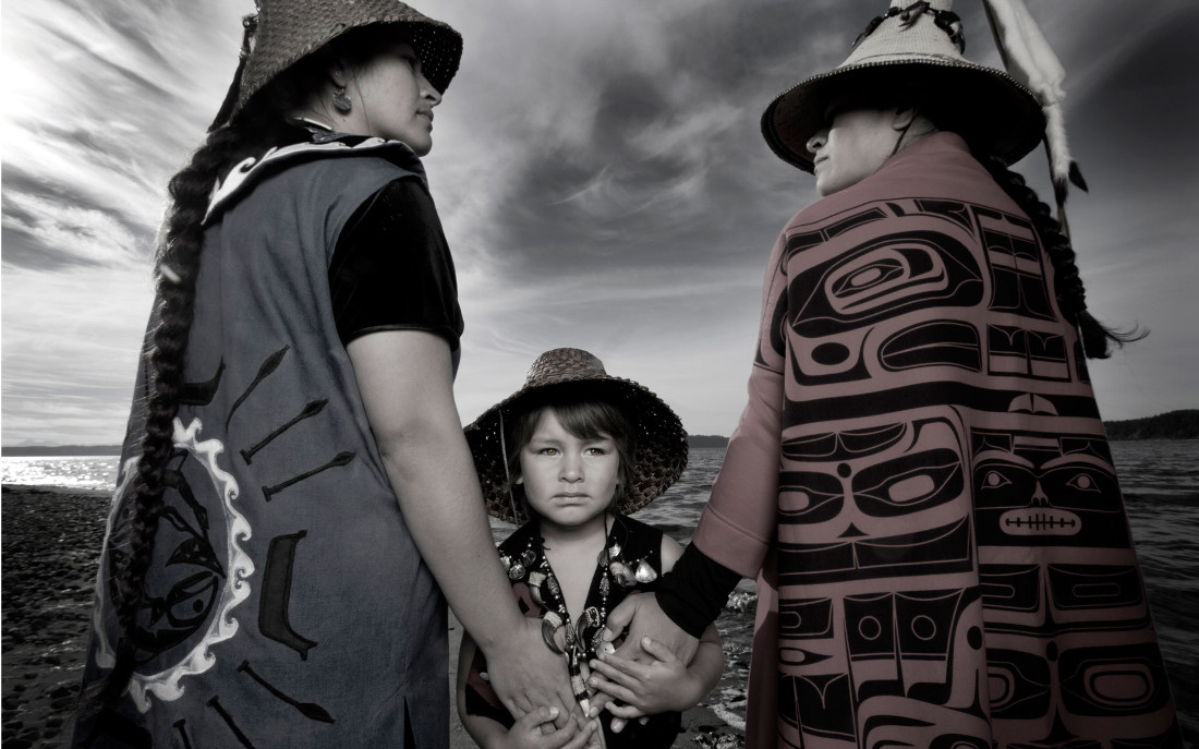 Darkfeather and Bibianna Ancheta, and Eckos Chartraw-Ancheta, of the Tulalip Tribes. Photographed by Matika Wilbur for Project 562.