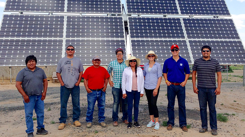 Native solar pioneer Debbie Tewa, center in white shirt, and colleagues. This solar array on the Hopi Reservation opened in June 2015. | Photo: Department of Energy