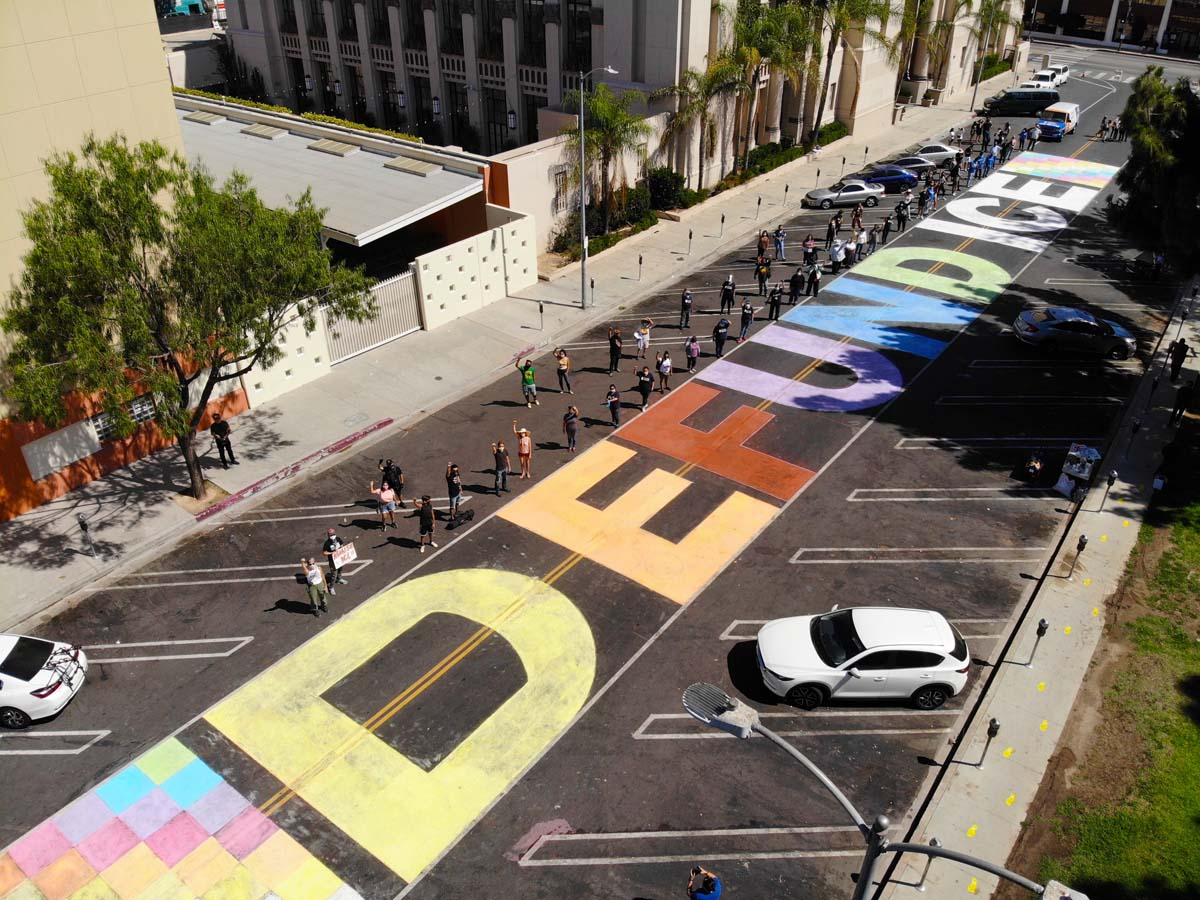 """Drone photo with the words """"DEFUND ICE"""" written in chalk during the Immigrant Detention Day of Action (Alfombra Centroamericana) organized by the coalition of Central American organizations 