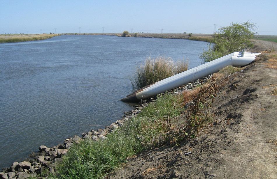 Pipes Drawing Water from Delta Waterway