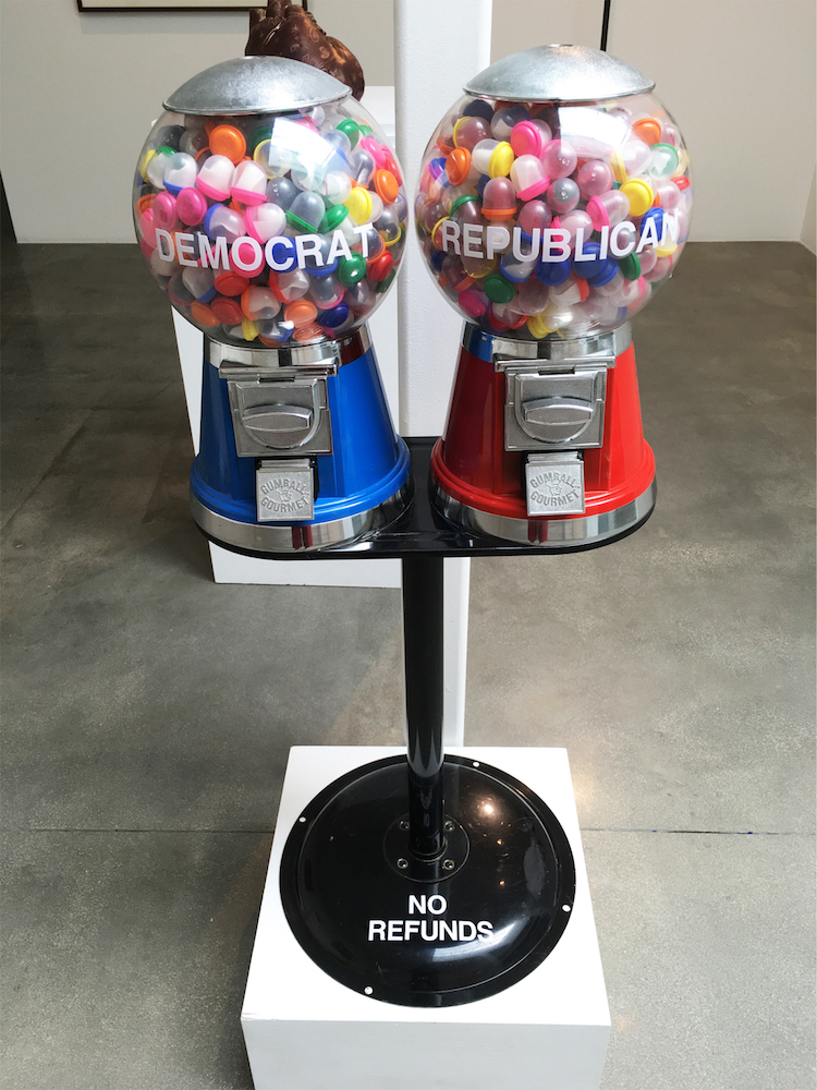 """Native American artist Gerald Clarke Jr. uses gumball machines to explore the electoral process in his sculpture """"Democracy for Sale"""""""