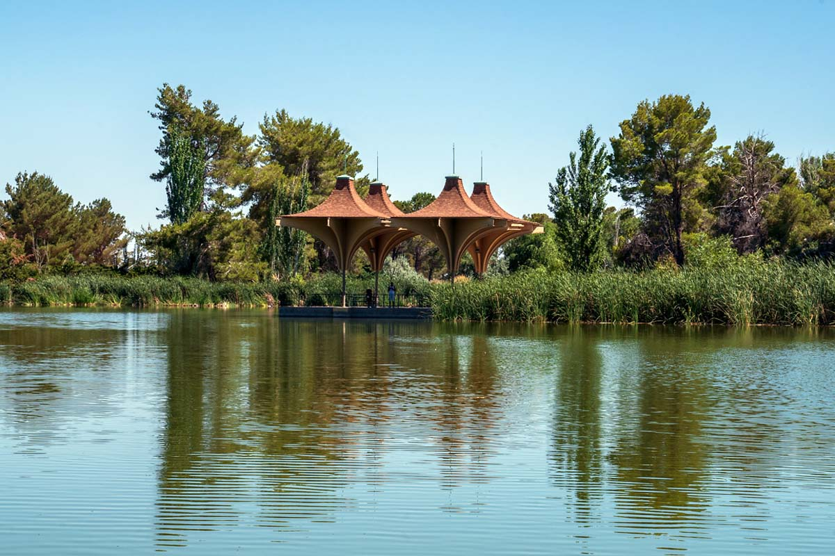 "The lake pavilion's unusual geometric ""parasol"" architectural flourishes were incorporated into the development's logo. | Kim Stringfellow"