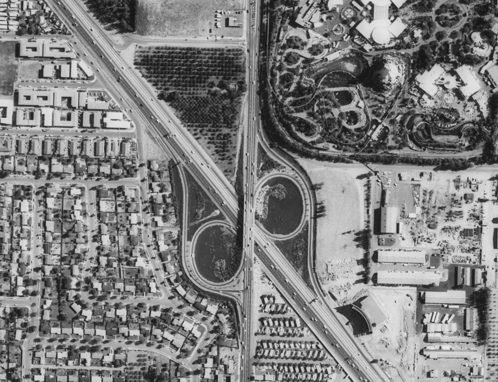 Aerial view of the Disneyland and the Santa Ana Freeway's Harbor Boulevard interchange, circa 1965