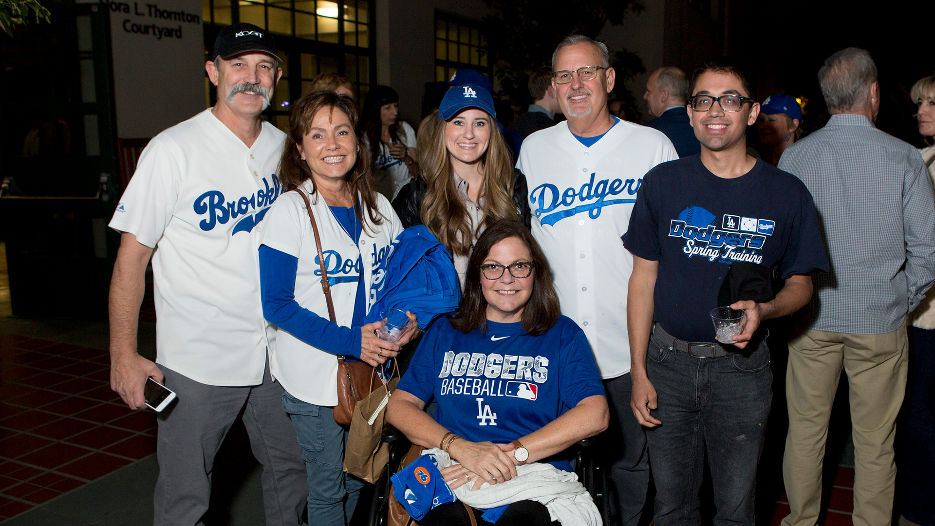 Longtime Dodgers fan, Scott Bell, and guests enjoy the reception after the screening at the Los Angeles Central Library on November 23, 2019.