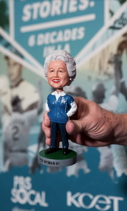 """Think Blue LA's, Ron Cervenka, holds a special thank you gift, a Rosalind """"Roz"""" Wyman bobblehead."""