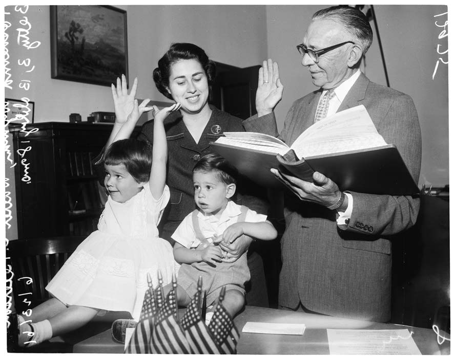 Roz Wyman (top left) being sowrn in for her third city council term, accompanied by her kids Betty and Bobby.  Los Angeles Examiner/USC Libraries/Corbis via Getty Images