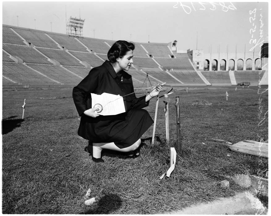 Rosalind Wyman checks home base and the general view at the Los Angeles Memorial Coliseum in preparation to receive the Dodgers for Opening Day. | Los Angeles Examiner/USC Libraries/Corbis via Getty Images