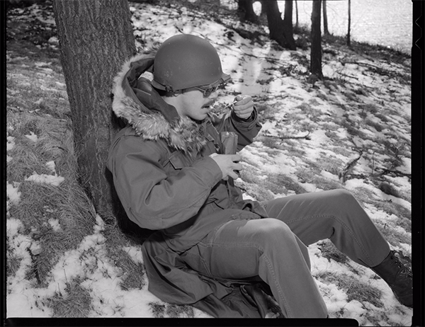 A soldier in 1976 testing out baked beans at U.S. Army Natick Research and Development Laboratories | Courtesy of Digital Commonwealth