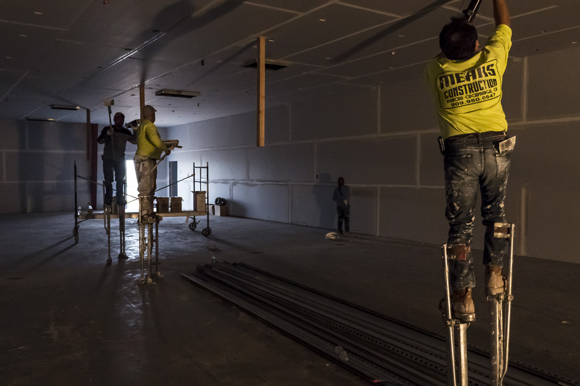 Dry wallers prepping an Adelanto warehouse for large-scale indoor commercial cannabis cultivation. Photo: Kim Stringfellow.