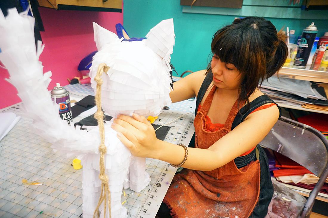 Yesenia prieto working on one of her piñatas | Courtesy of Piñata Design Studio