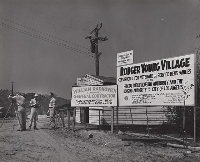 Contractors sign and workers at Roger Young Village | Housing Authority of the City of Los Angeles