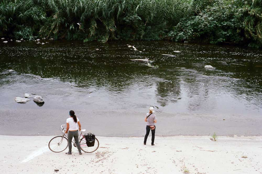 Two women admire the L.A. River from the concrete riverside. | Taylor Fitz-Gibbon