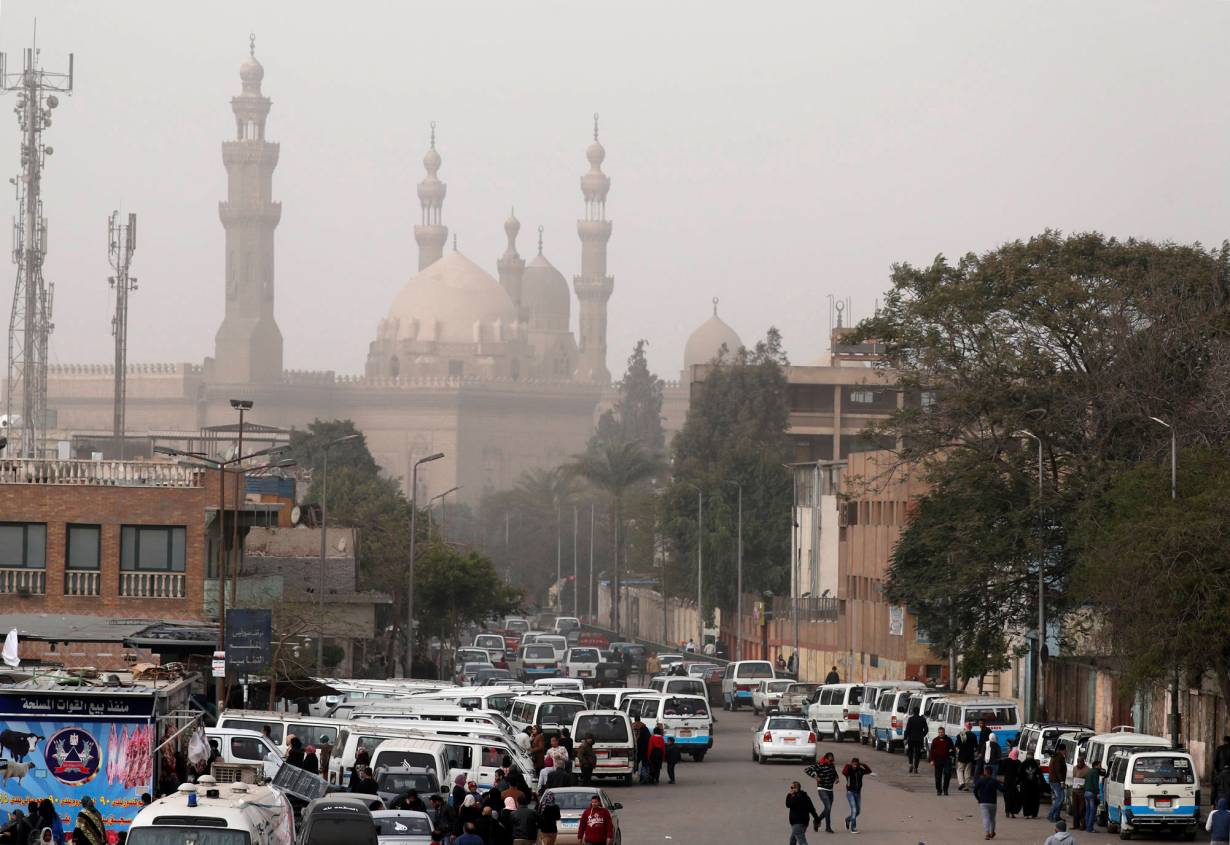 The minarets of Sultan Hassan Mosque and the Al-Rifa'i Mosque are seen as a traffic jam forms during a sandstorm in Cairo, Egypt January 6, 2019.   REUTERS/Amr Abdallah Dalsh
