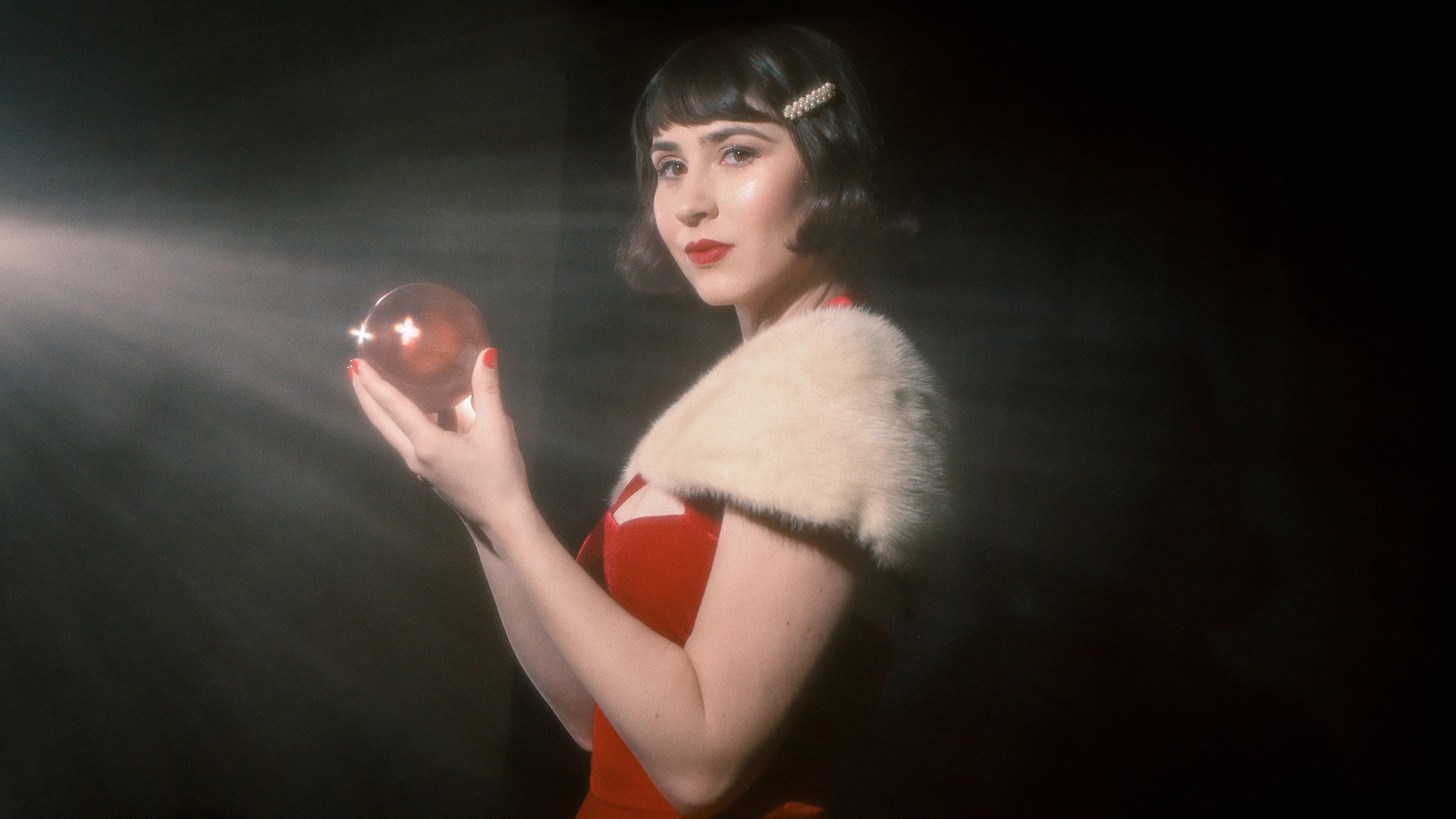 Elizabeth Messick poses with a red orb. | Kalie Johnson