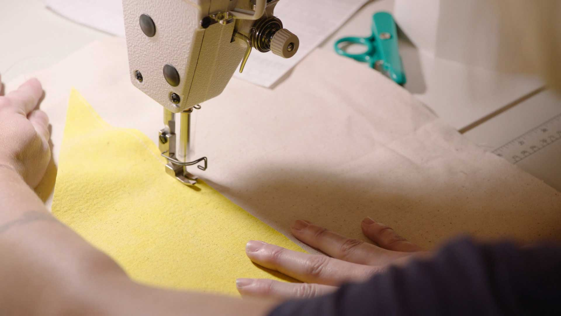 """Emily Marchand sewing her oversized picnic blanket   Still from """"Artbound"""" Current:LA"""