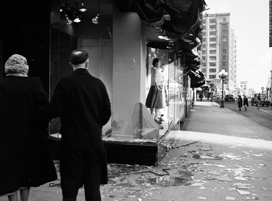 Passersby stop to look at shattered windows at Broadway and 9th in downtown Los Angeles on March 1, 1952. Courtesy of the Los Angeles Examiner Collection, USC Libraries.