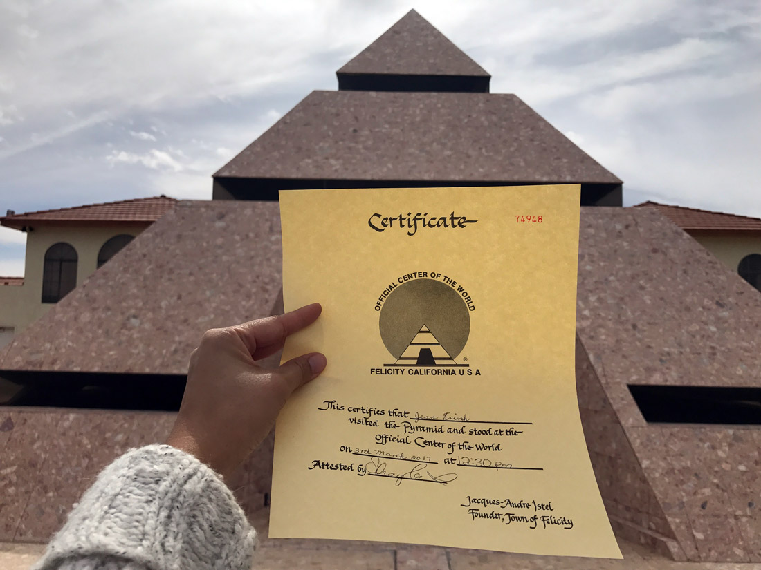 Certificate visitors receive for standing in the pyramid at the Center of the World in Felicity | Jean Trinh