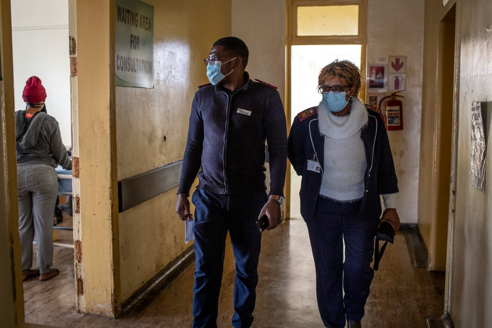 The only two Nurses on duty, Sipho Wilson Batlhaping (29) and Ruth Seikaneng (64) walk through a corridor of the Reivilo Health Centre in Reivilo on Sept. 3, 2020.   Thomson Reuters Foundation/Gulshan Khan