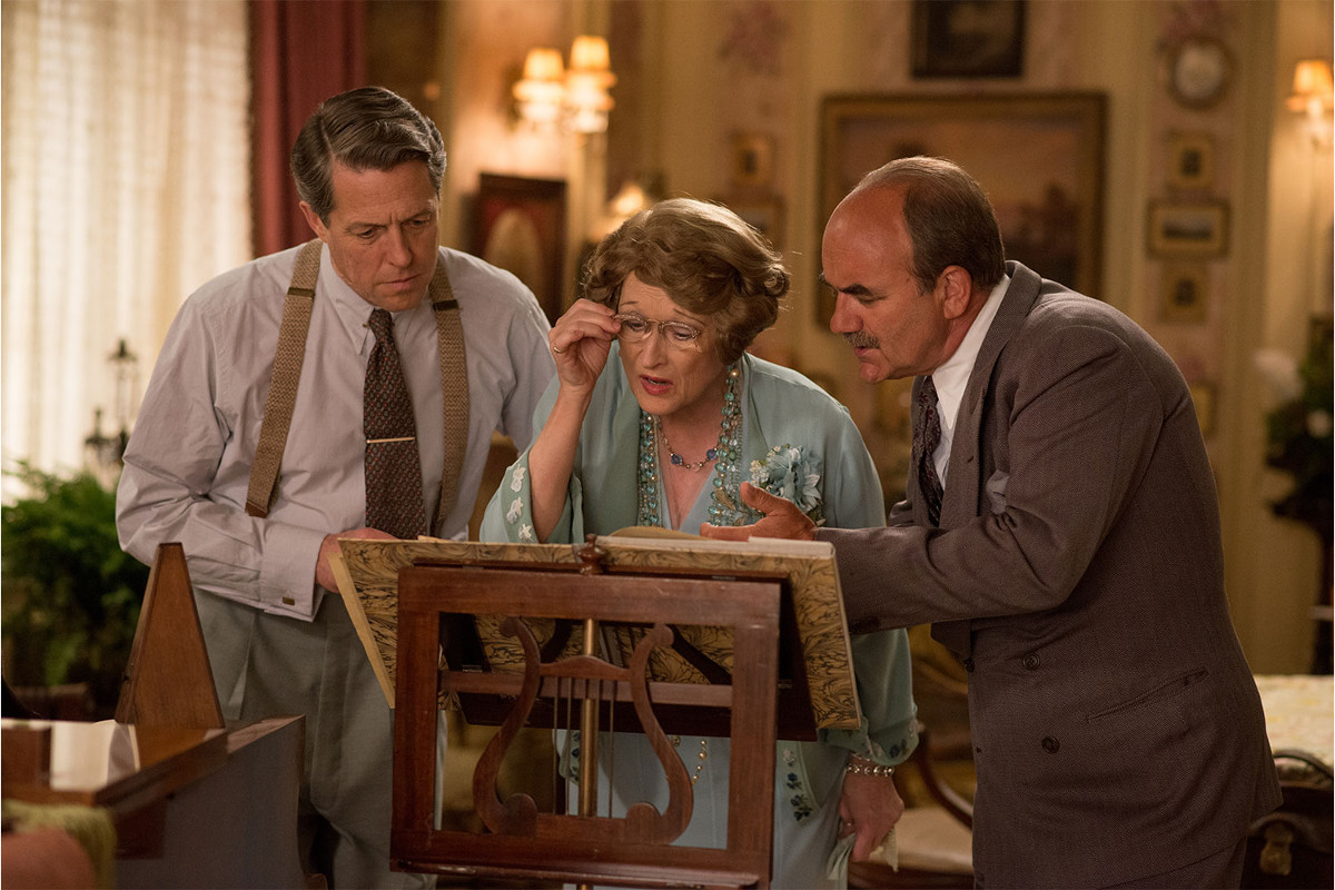"Hugh Grant (left), Meryl Streep (center), and David Haig (right) in ""Florence Foster Jenkins."""