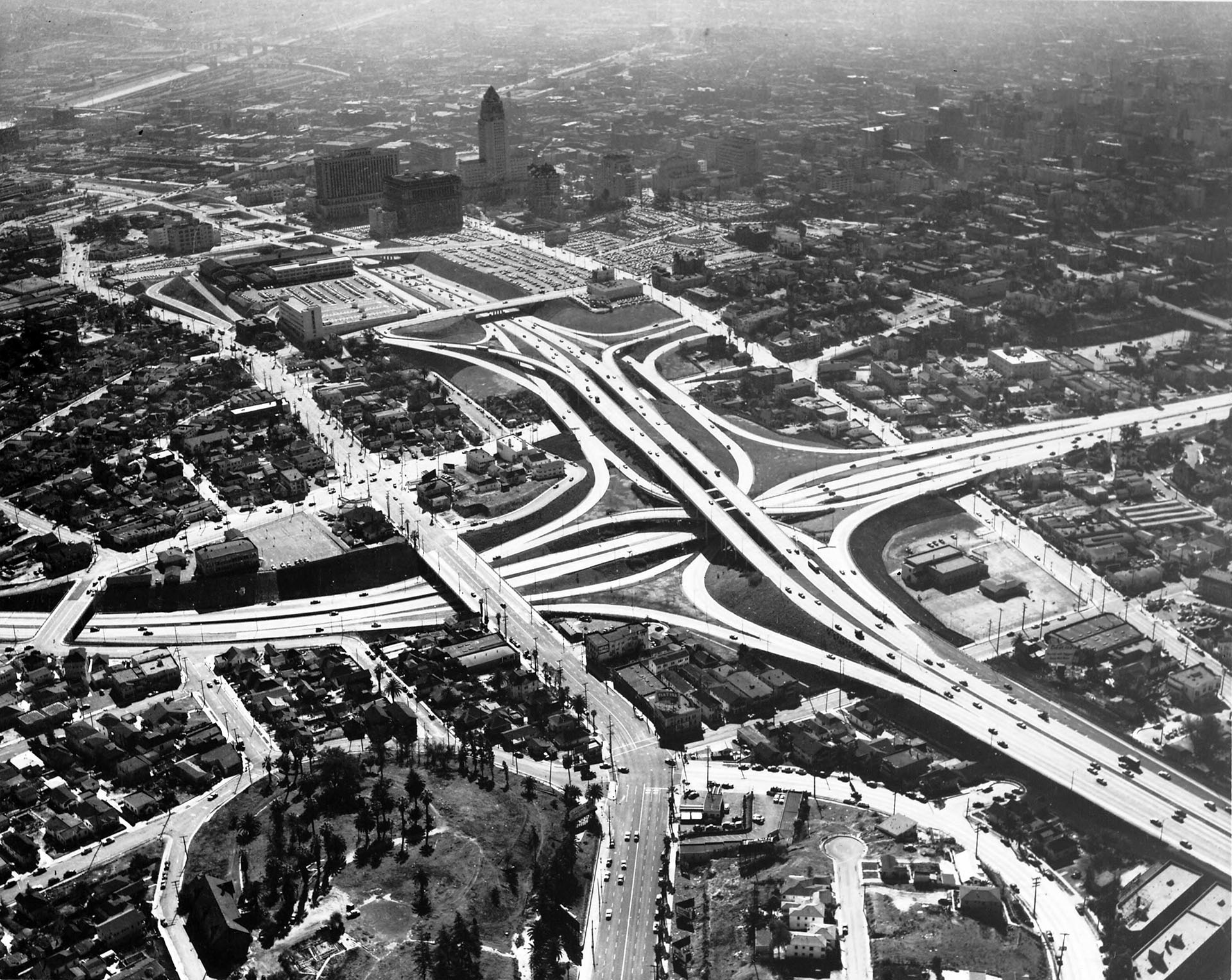 Aerial view of downtown Los Angeles from the Harbor Freeway and Hollywood Freeway interchange, 1954