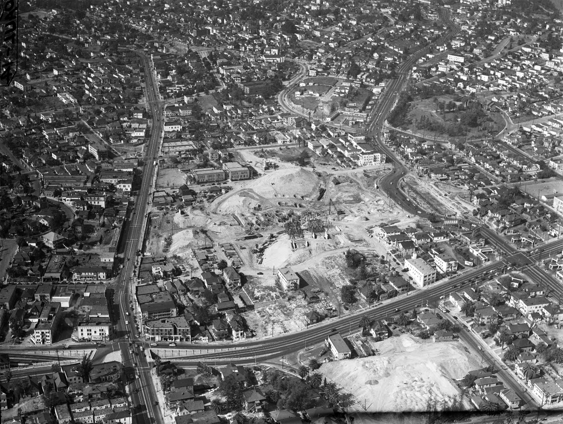 Aerial view of massive excavation and construction work for the interchange joining Arroyo Seco [Pasadena], Harbor, Hollywood and Santa Ana freeways, 1948