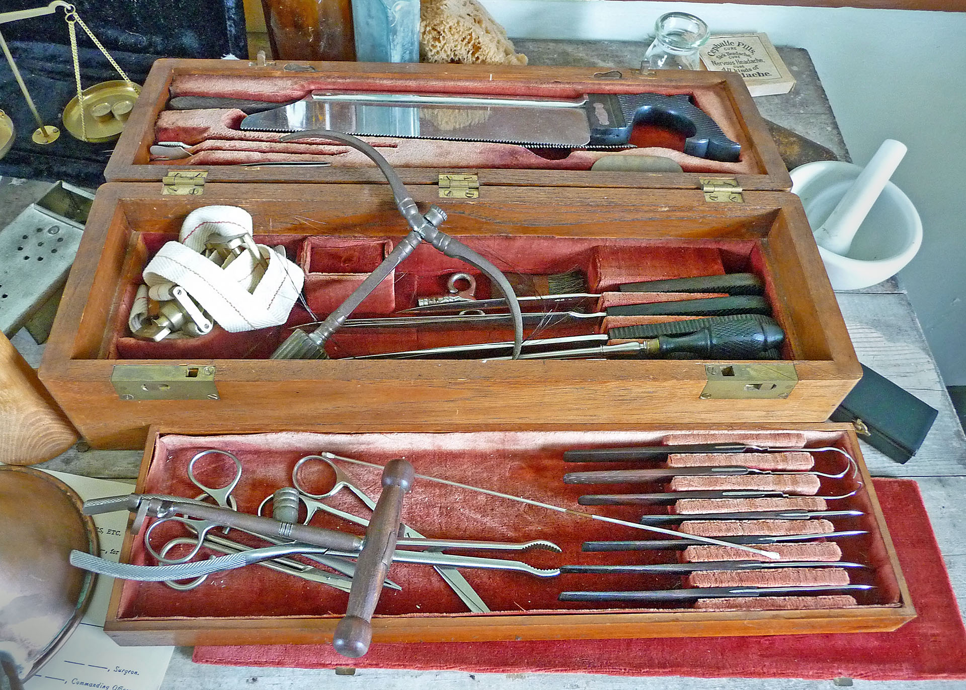 Frontier Medicine, 1865. Bone saw, tourniquet, scalpels, and other implements were standard equipment in a mid-century medical kit. Photograph courtesy of Wikimedia.
