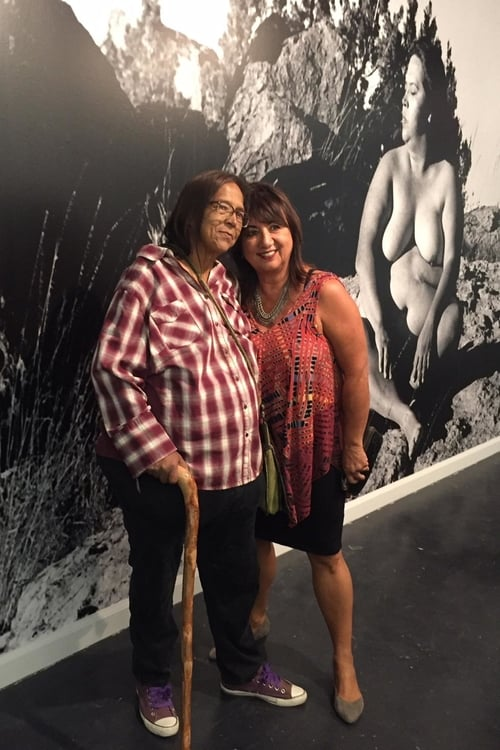"""Laura Aguilar with Sybil Venegas at the the artist's retrospective """"Show and Tell"""" at Vincent Price Art Museum 