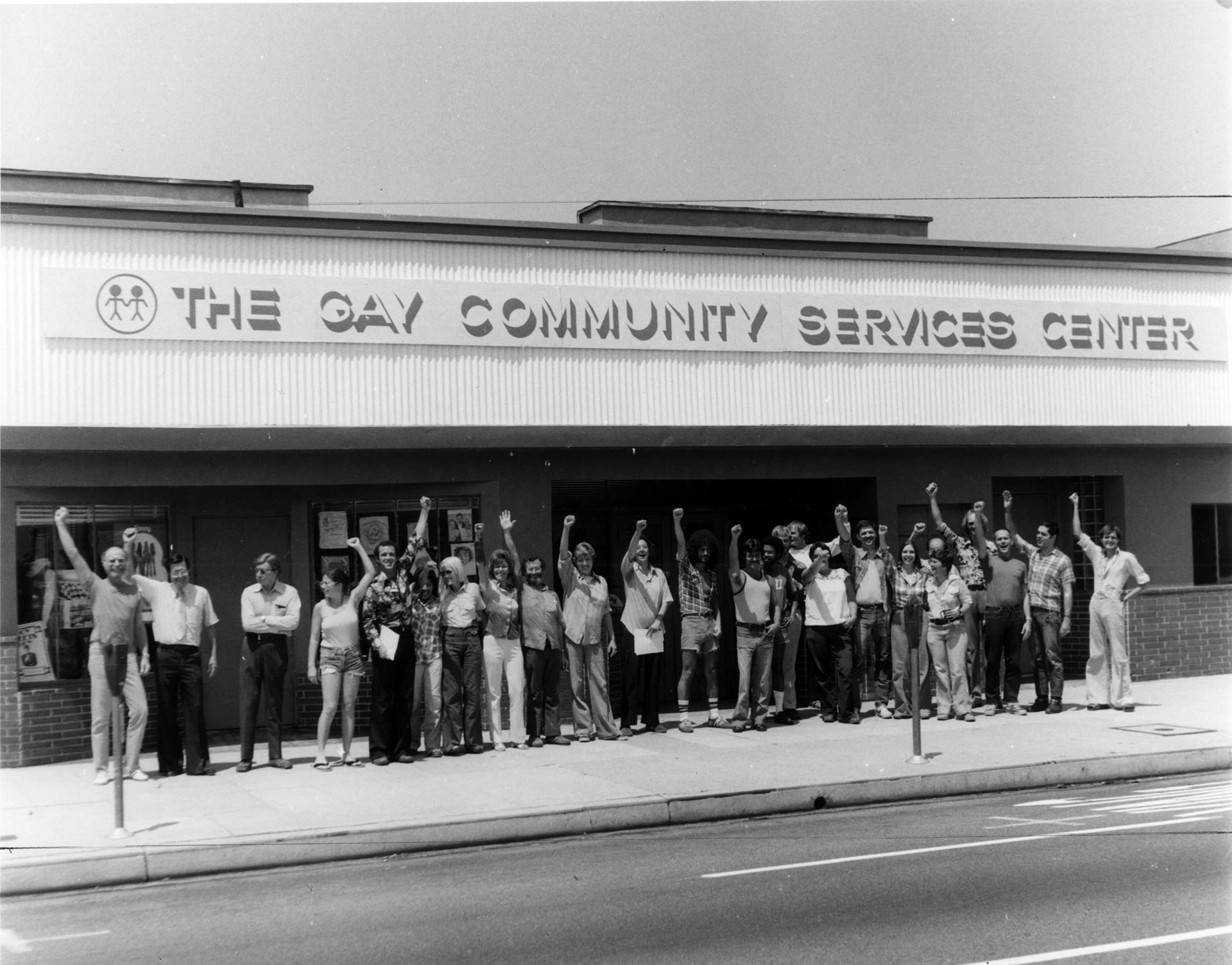 Two dozen supporters stand in front of the Gay Community Services Center, circa 1974