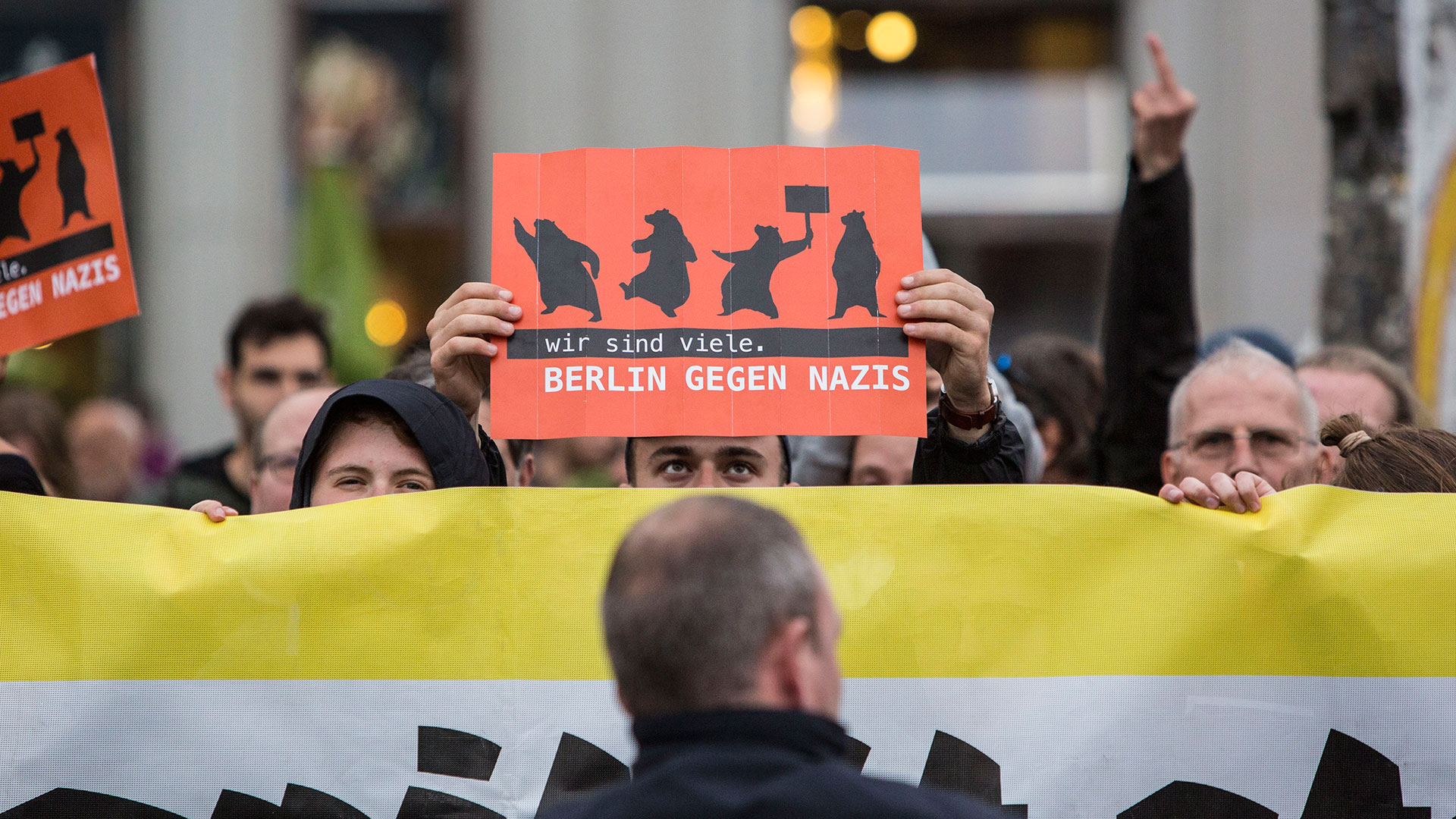 "Germany Decides: Counter demonstrator holding a sign reading ""Berlin against Nazis"" at anti-Merkel rally."