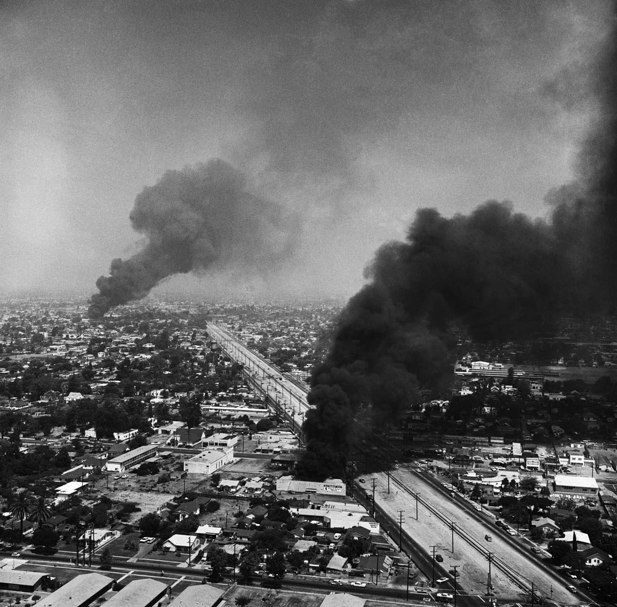Black smoke darkens the sky over Southeast Los Angeles, during the fourth day of the Watts Uprising   Getty Images