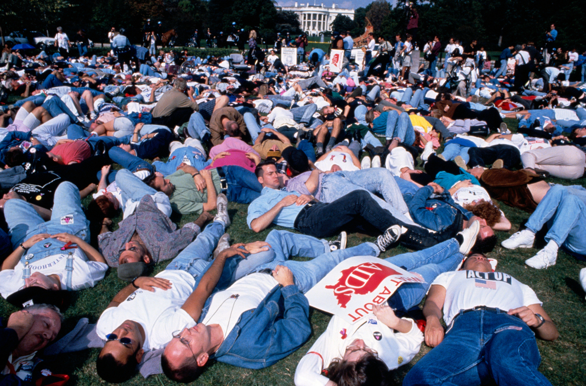 AIDS protest in front of the White House. ACT UP activists stage a die-in on the lawn in front of the Capitol building.  | Photo: Jeffrey Markowitz/Sygma via Getty Images