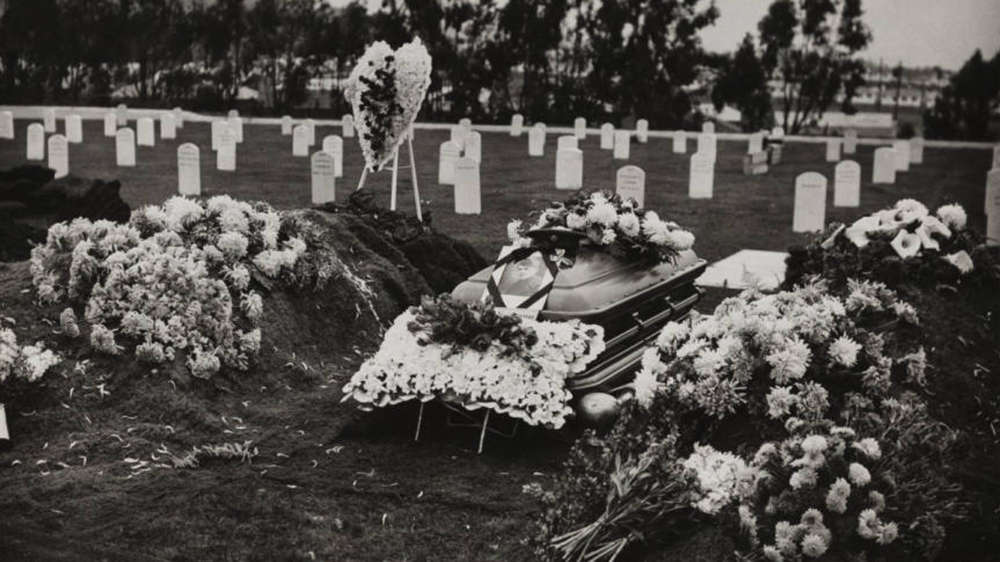 A photograph of Hiroshi Sugiyama's decorated casket and gravesite at his reburial ceremony, 1948 December 15 | Go for Broke National Education Center Collection, USC Libraries