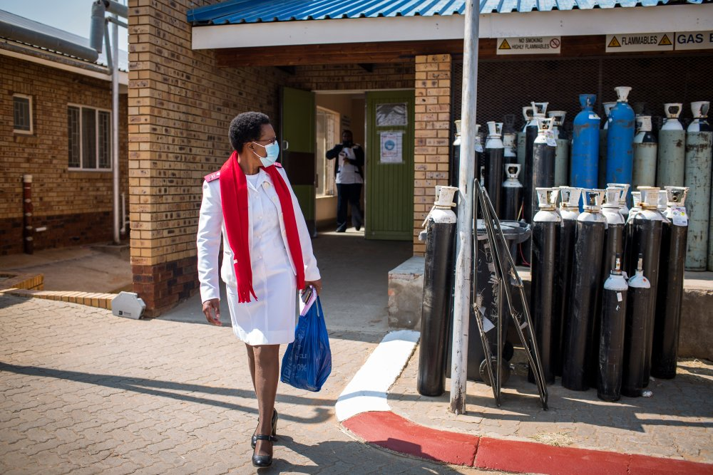 Kedibone Mdolo, projects coordinator of the Democratic Nursing Organisation of South Africa (DENOSA) looks back at empty oxygen tanks waiting to be collected at the Taung Hospital in Taung, North West Province, South Africa, on Sept. 3, 2020.   TRF