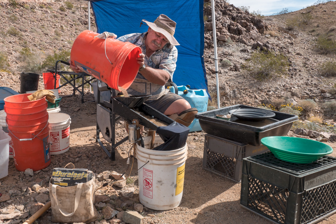 Steve Hartenstine operates a small, battery-powered sluice using recycled water at First Class Miner's Middle Camp claim located east of Joshua Tree National Park | Kim Stringfellow