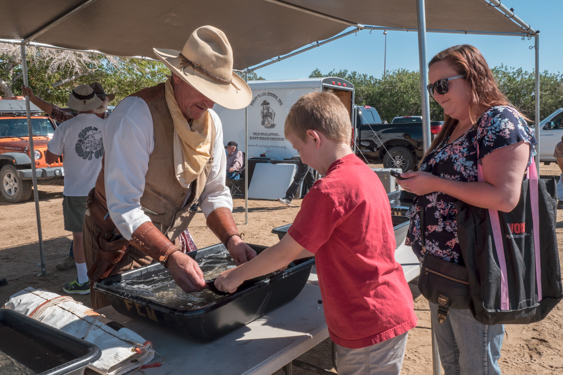 FCM's current Vice President Greg Herring shows a boy how to pan for gold at the annual Joshua Tree Gem & Mineral Show. | Kim Stringfellow