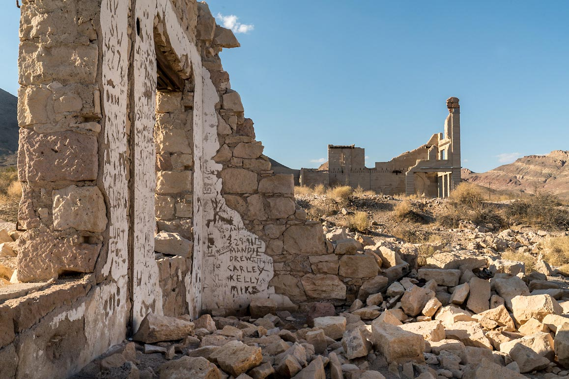 The ruins of Rhyolite's John S. Cook & Co. Bank (at right back) | Kim Stringfellow, August 2018.