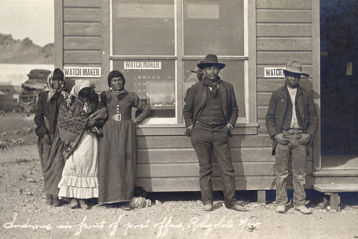 A group of Shoshone in front of Rhyolite's post office, ca. 1906. | A.E. Holt. Courtesy of University of Nevada, Reno, Special Collections.