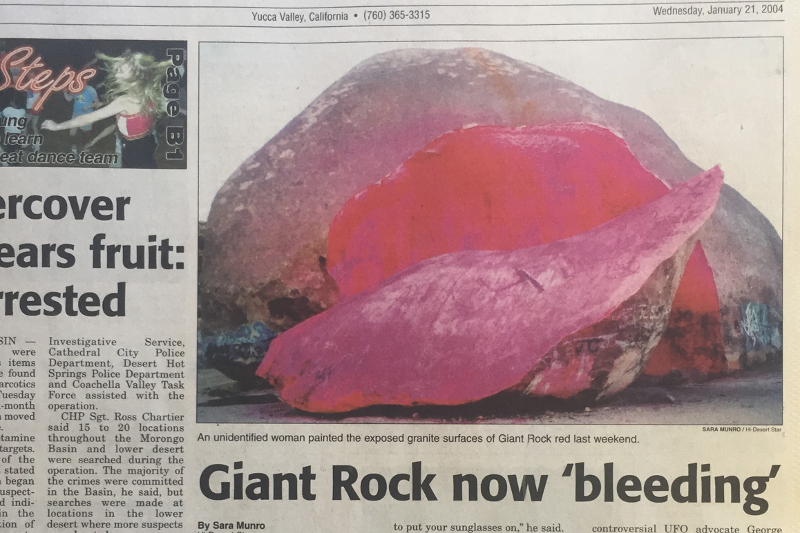 """On January 21, 2004, the Hi-Desert Star reported that an unidentified woman spray painted the boulder's exposed surfaces bright red as an """"artistic"""" intervention """"expressing the rock's pain."""" 