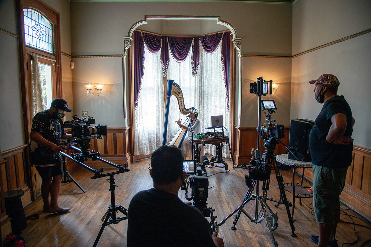 The Grand Performances team films Low Leaf performing inside the Perry House at Heritage Square Museum. | Azul Amaral