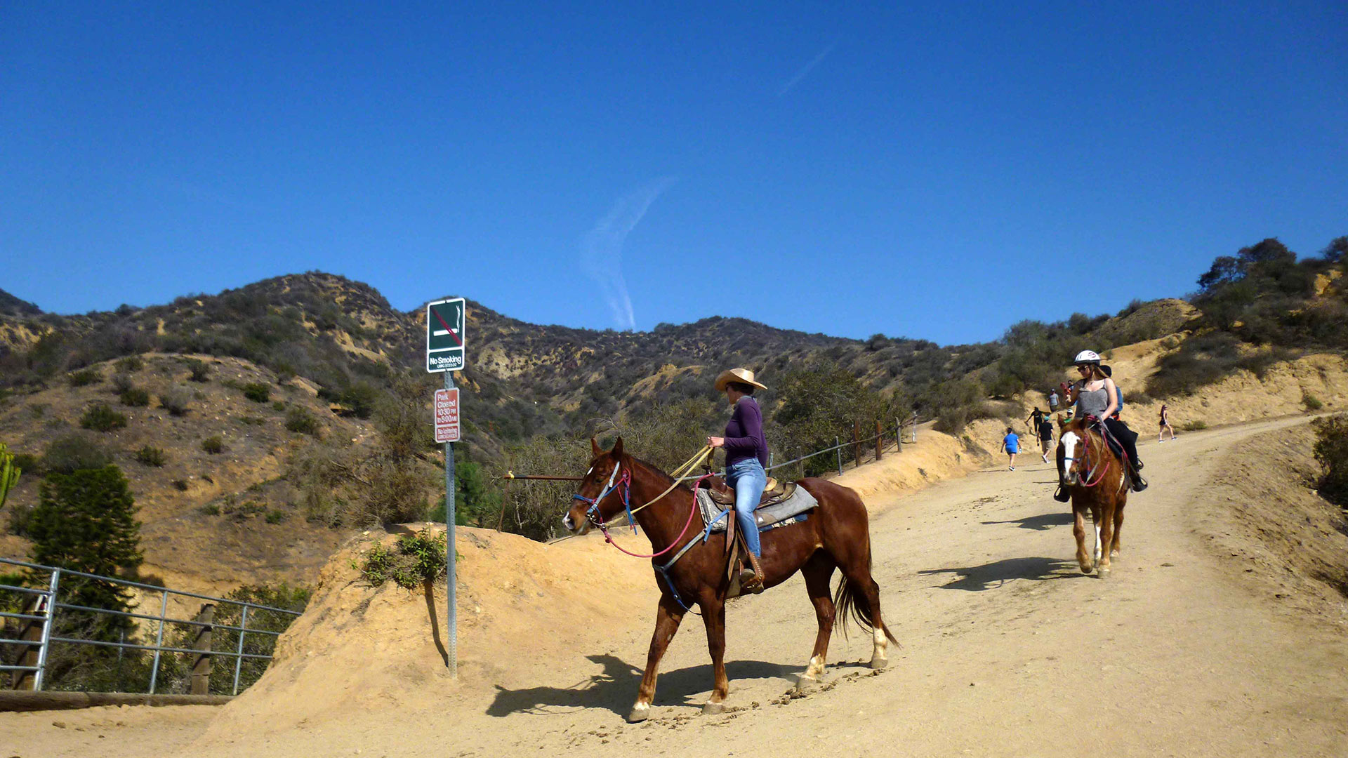 Two women ride on horseback in Griffith Park | Sandi Hemmerlein