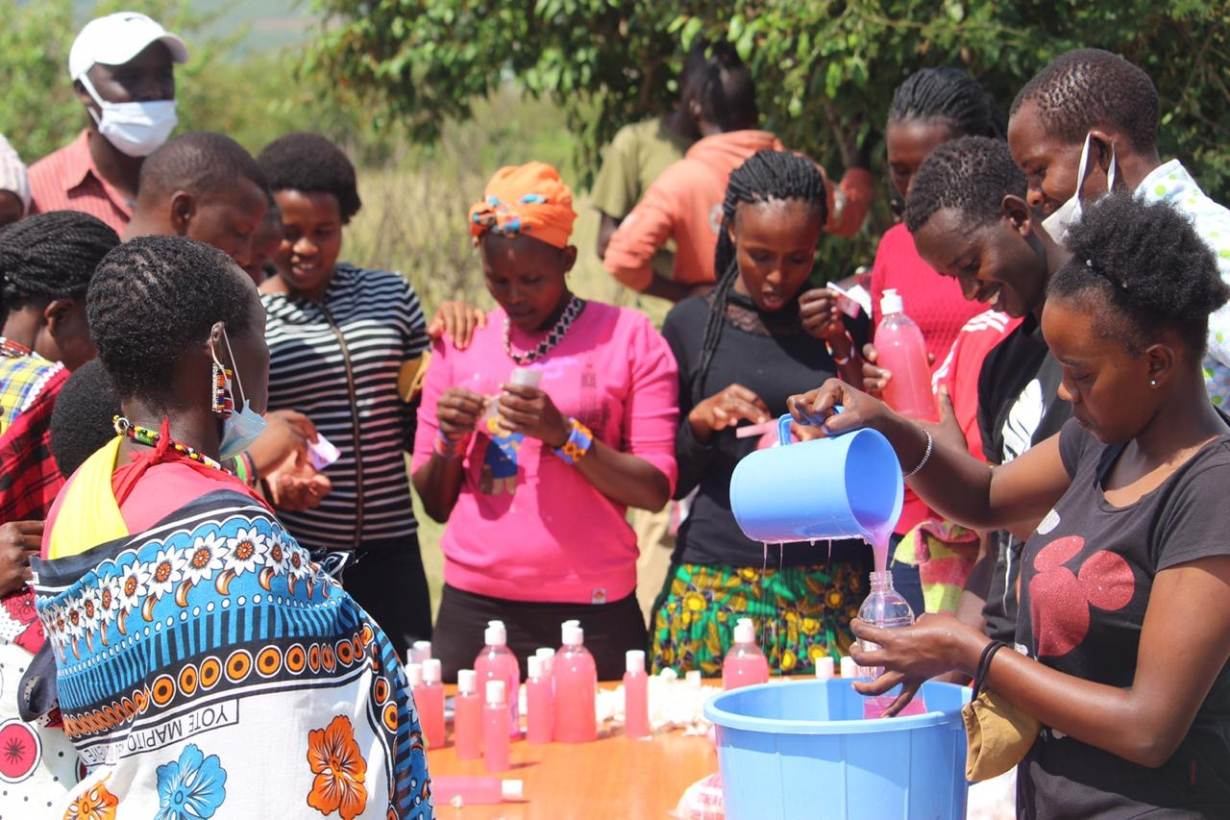 Maasai women learn how to produce hand sanitizers at the Nashulai Maasai Conservancy, located near the Maasai Mara National Reserve in Narok county, Kenya. | PHOTO COURTESY: Nelson Ole Reiyia, Nashulai Maasai Conservancy