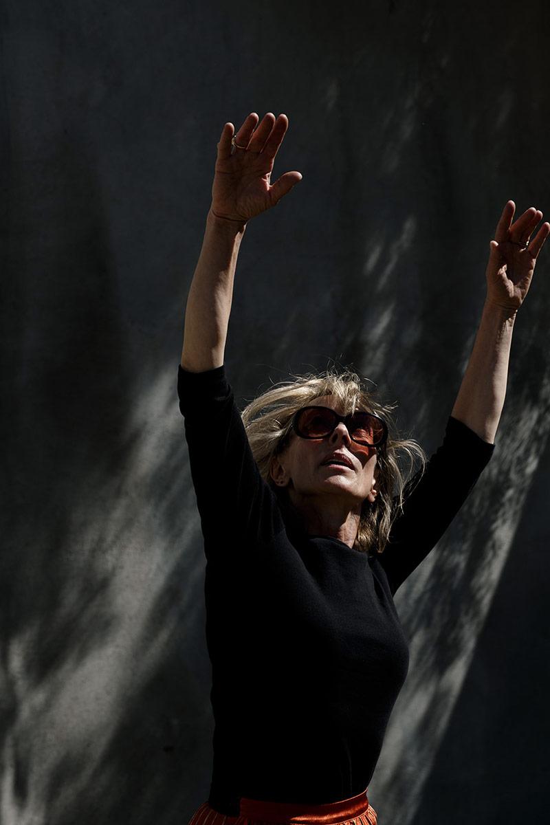 Heidi Duckler stretches her hands towards the sky. | Courtesy of Heidi Duckler