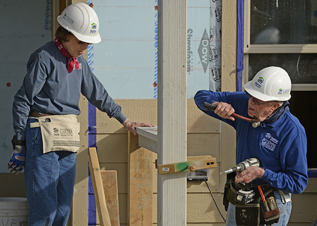 Rosalynn Carter and her husband, Jimmy, work on building a home during Habitat for Humanity's Carter Work Project event in Denver, 2013. | RJ Sangosti/Getty Images